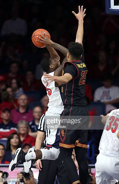 Bennie Boatwright of the USC Trojans defends against Kadeem Allen of the Arizona Wildcats during the second half of the college basketball game at...