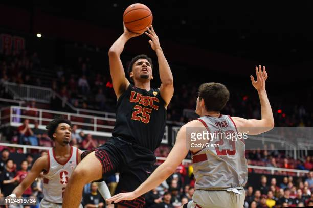 Bennie Boatwright of the USC Trojans drives on Cormac Ryan during their game at Maples Pavilion on February 13 2019 in Palo Alto California