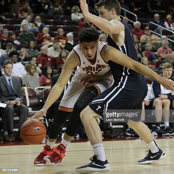 Bennie Boatwright of the USC Trojans drives to the basket against Eric Anderson of the Yale Bulldogs in a NCAA college basketball game at Galen...