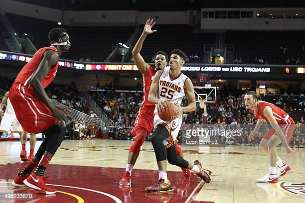 Bennie Boatwright of the USC Trojans drives to the basket against Tim Williams of the New Mexico Lobos in a NCAA college basketball at Galen Center...