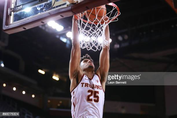 Bennie Boatwright of the USC Trojans dunks the ball against the Santa Clara Broncos during a college basketball game at Galen Center on December 14...
