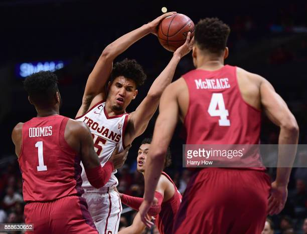Bennie Boatwright of the USC Trojans grabs a rebound in front of Rashard Odomes and Jamuni McNeace of the Oklahoma Sooners during the Basketball Hall...