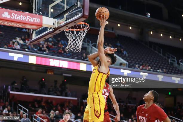 Bennie Boatwright of the USC Trojans handles the ball against Arinze Chidom of the Washington State Cougars during a PAC12 college basketball game at...