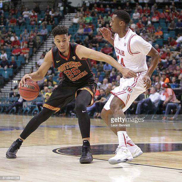 Bennie Boatwright of the USC Trojans handles the ball against Dakarai Tucker of the Utah Utes during a quarterfinal game of the Pac12 Basketball...