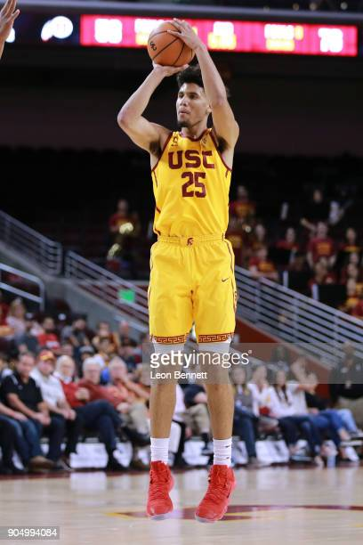 Bennie Boatwright of the USC Trojans handles the ball against Jayce Johnson of the Utah Utes during a PAC12 college basketball game at Galen Center...