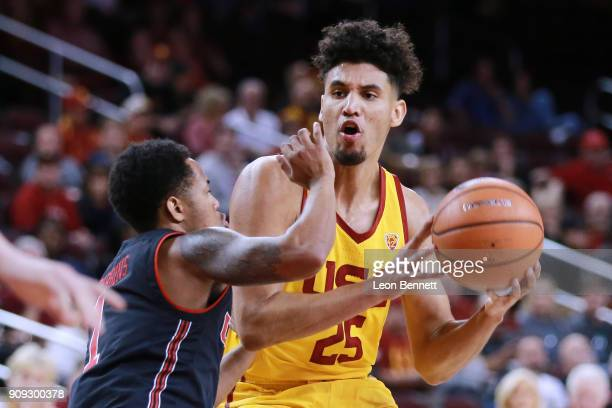 Bennie Boatwright of the USC Trojans handles the ball against Justin Bibbins of the Utah Utes during a PAC12 college basketball game at Galen Center...