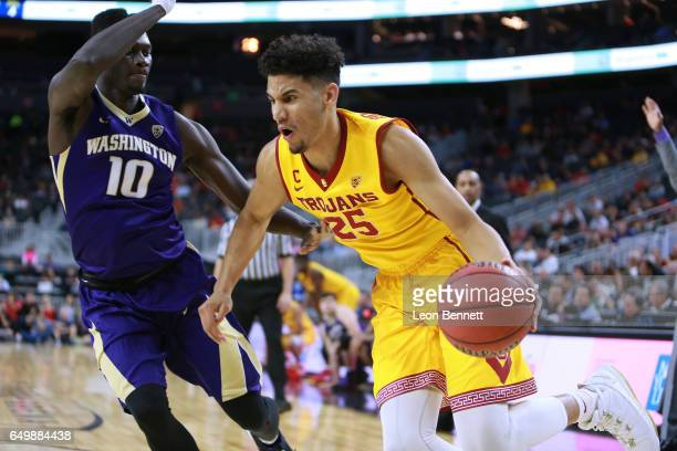 Bennie Boatwright of the USC Trojans handles the ball against Malik Dime of the Washington Huskies during a firstround game of the Pac12 Basketball...