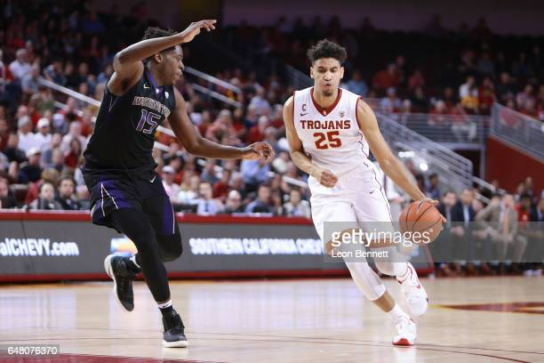 Bennie Boatwright of the USC Trojans handles the ball against Noah Dickerson of the Washington Huskies during a Pac12 conference college basketball...