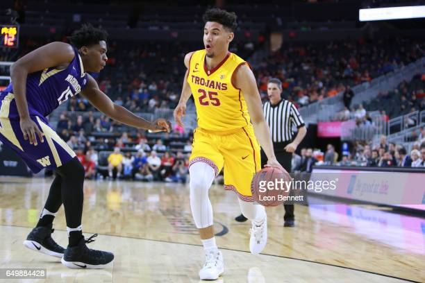 Bennie Boatwright of the USC Trojans handles the ball against Noah Dickerson of the Washington Huskies during a firstround game of the Pac12...