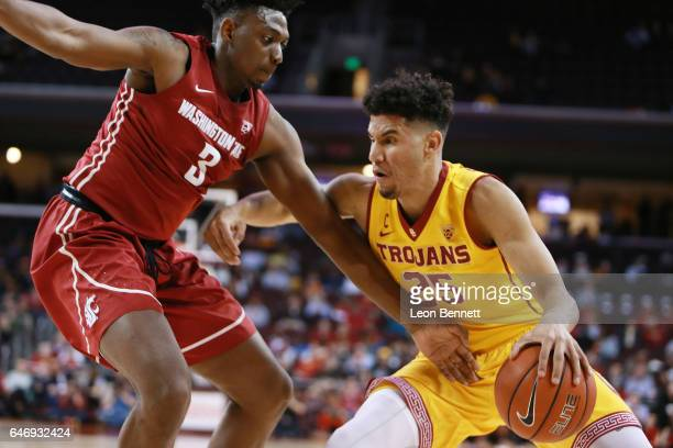 Bennie Boatwright of the USC Trojans handles the ball against Robert Franks of the Washington State Cougars during a Pac12 conference college...