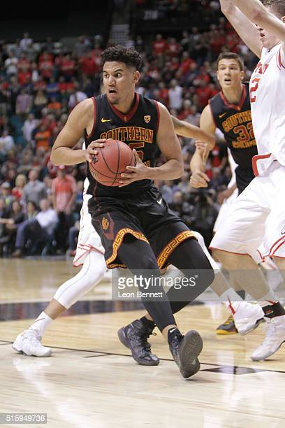 Bennie Boatwright of the USC Trojans handles the ball against the Utah Utes during a quarterfinal game of the Pac12 Basketball Tournament at MGM...