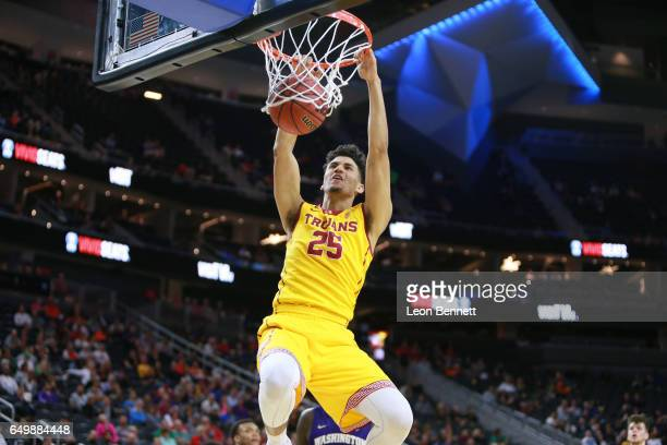 Bennie Boatwright of the USC Trojans handles the ball against the Washington Huskies during a firstround game of the Pac12 Basketball Tournament at...
