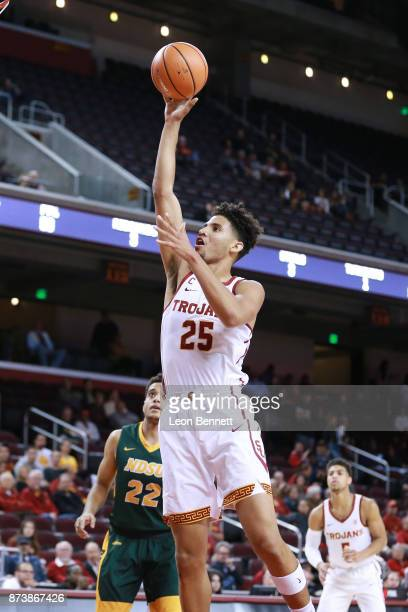 Bennie Boatwright of the USC Trojans handles the ball against the North Dakota State Bison during a college basketball game at Galen Center on...