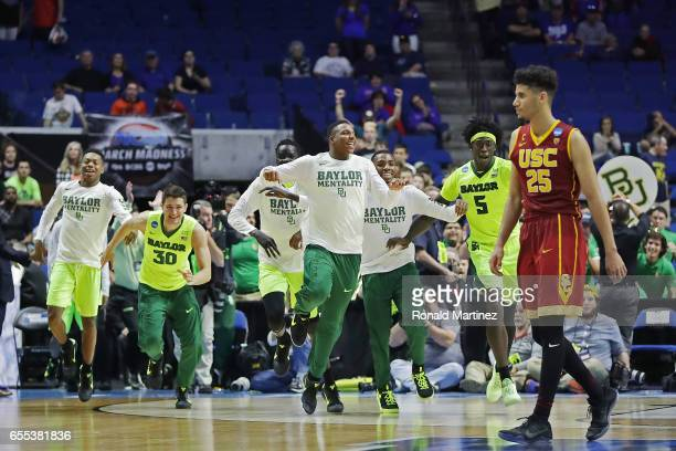 Bennie Boatwright of the USC Trojans reacts as the Baylor Bears celebrate their 8278 victory over the USC Trojans during the second round of the 2017...
