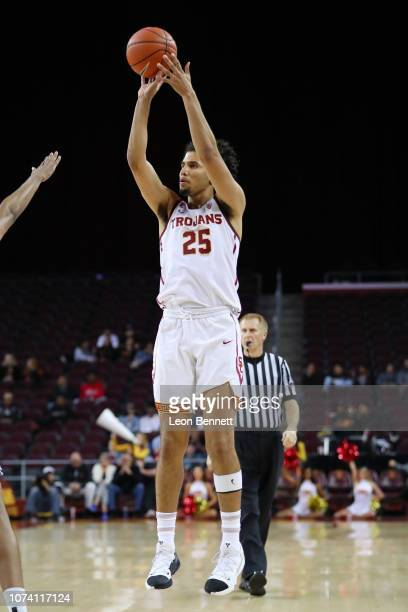 Bennie Boatwright of the USC Trojans shoot the deep three against the Long Beach State 49ers during a college basketball game at Galen Center on...