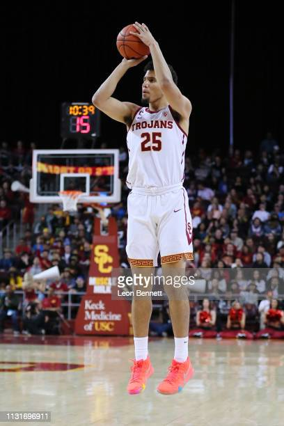 Bennie Boatwright of the USC Trojans shoot the deep three against the Oregon State Beavers during a college basketball game at Galen Center on...