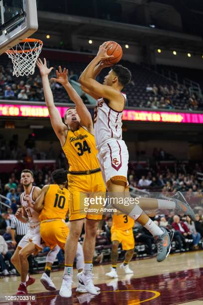 Bennie Boatwright of the USC Trojans shoots a basket against Grant Anticevich of the Cal Bears at The Galen Center on January 3 2019 in Los Angeles...
