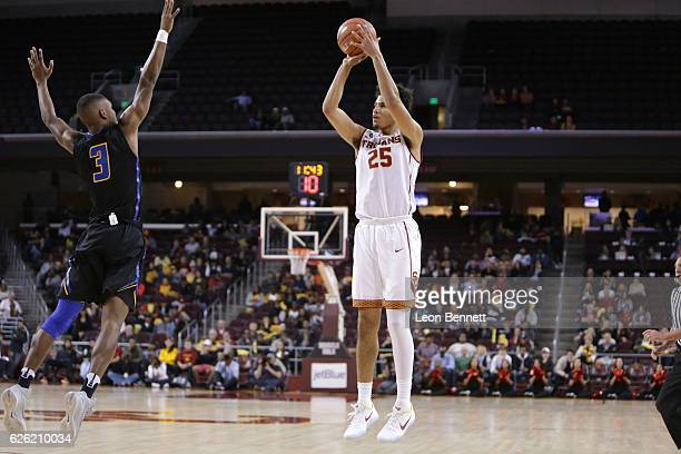 Bennie Boatwright of the USC Trojans shoots a threepointer over Clifton Powell of the UC Santa Barbara Gauchos during a NCAA college basketball game...
