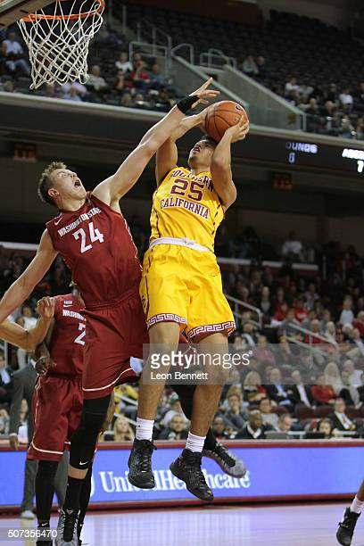 Bennie Boatwright of the USC Trojans shoots for two over Josh Hawkinson of the Washington Cougars during a NCAA Pac12 college basketball game at the...