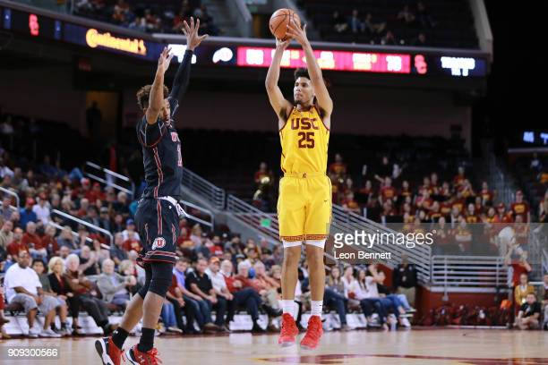 Bennie Boatwright of the USC Trojans shoots the ball against Chris Seeley of the Utah Utes during a PAC12 college basketball game at Galen Center on...