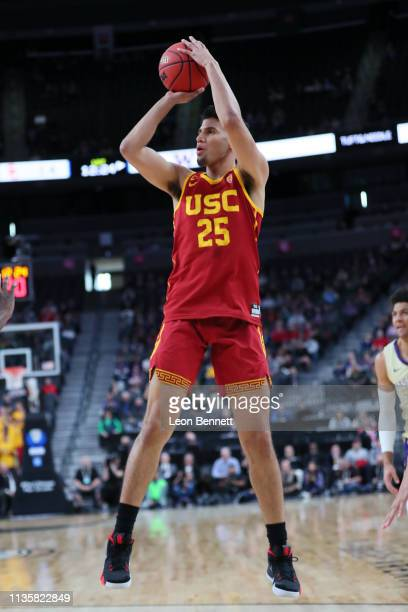 Bennie Boatwright of the USC Trojans shoots the ball against the Washington Huskies during a quarterfinal game of the Pac12 basketball tournament at...