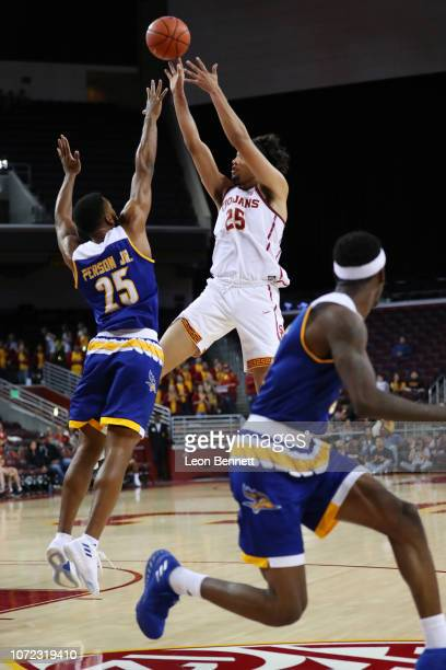 Bennie Boatwright of the USC Trojans shoots the ball over Darrin Person Jr #25 of the Cal State Bakersfield Roadrunners during a college basketball...