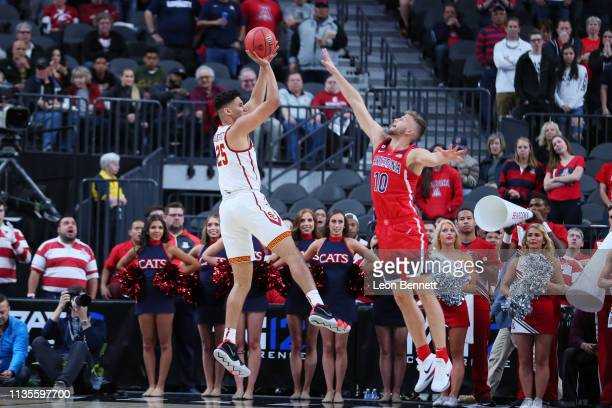 Bennie Boatwright of the USC Trojans shoots the ball over Ryan Luther of the Arizona Wildcats during a firstround game of the Pac12 basketball...