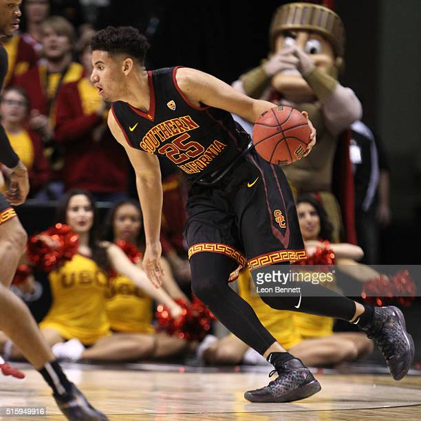 Bennie Boatwright of USC Trojans handles the ball against the Utah Utes during a quarterfinal game of the Pac12 Basketball Tournament at MGM Grand...