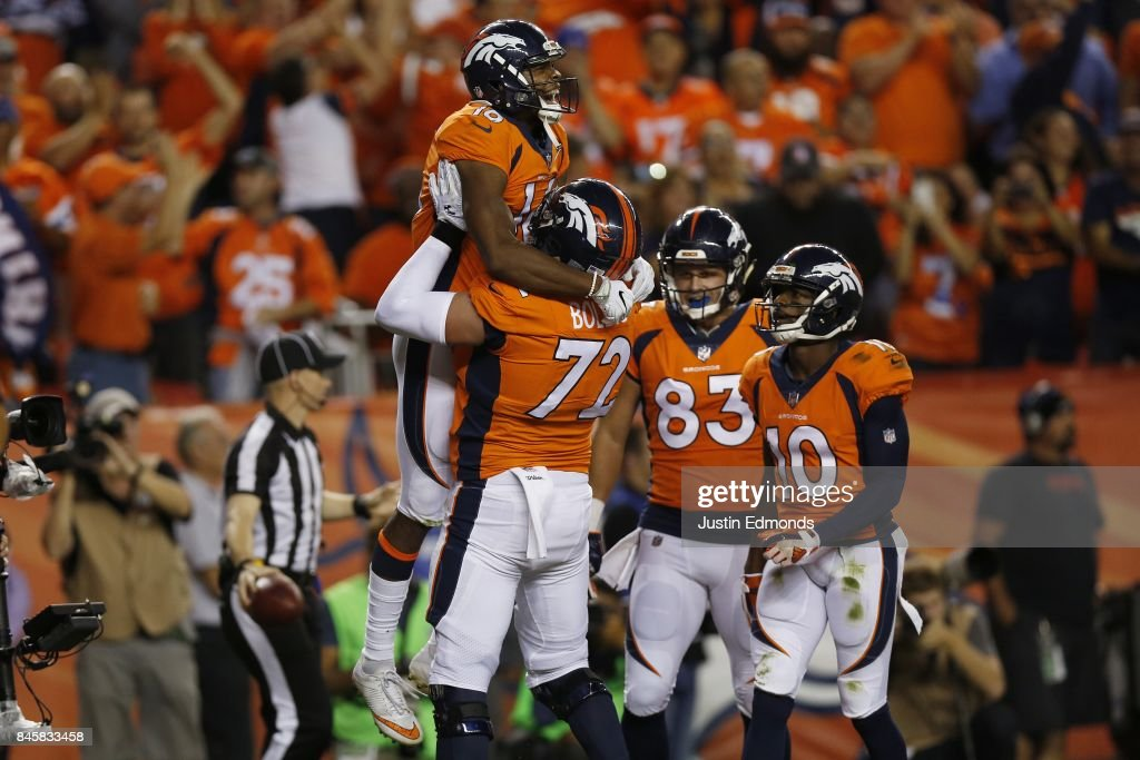 Bennie Fowler #16 celebrates a touchdown catch with offensive tackle Garett Bolles #72 of the Denver Broncos in the first quarter of the game abasing the Los Angeles Chargers at Sports Authority Field at Mile High on September 11, 2017 in Denver, Colorado.