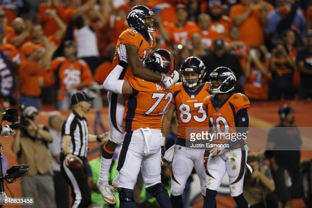 Bennie Fowler celebrates a touchdown catch with offensive tackle Garett Bolles of the Denver Broncos in the first quarter of the game abasing the Los...
