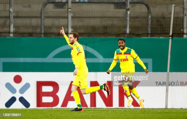 Benno Schmitz of 1. FC Koeln celebrates with team mate Emmanuel Bonaventure after scoring their side's second goal during the DFB Cup Round of...