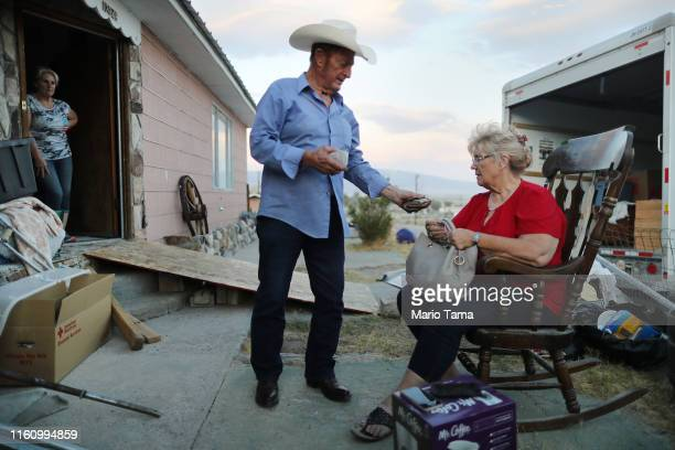 Benny and Anna Sue Eldridge gather outside their home which has been deemed uninhabitable due to structural damage from the recent 71 magnitude...