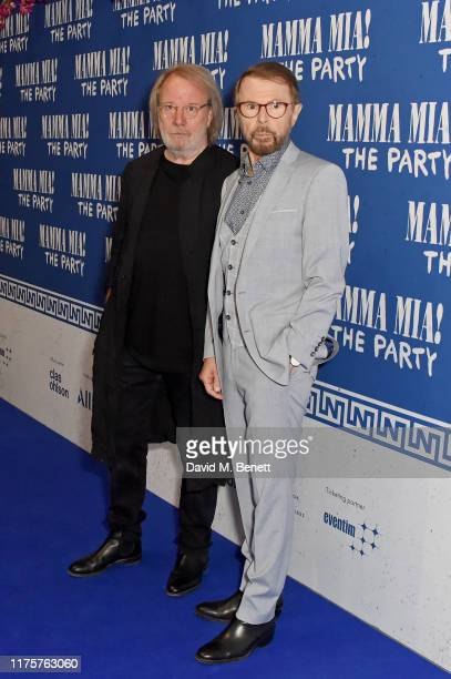 Benny Andersson and Bjorn Ulvaeus attend the opening night of MAMMA MIA The Party at Building 6 at The O2 on September 19 2019 in London England