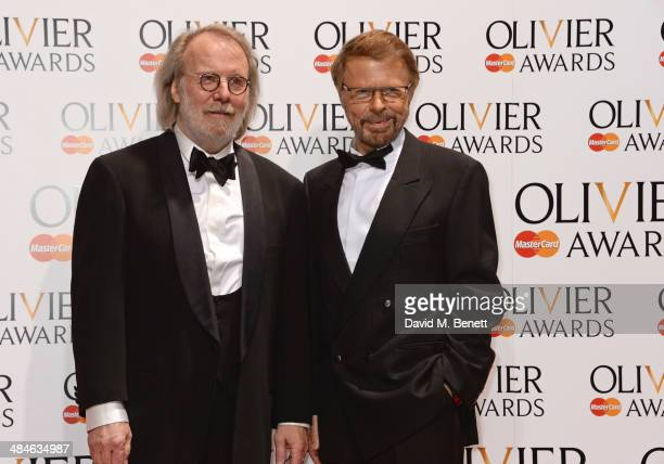 Benny Andersson and Bjorn Ulvaeus of ABBA pose in the press room at the Laurence Olivier Awards at The Royal Opera House on April 13 2014 in London...