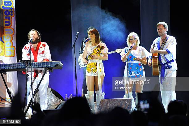 Benny Anderwear Frida Longstokin Agnetha Falstart and Bjorn Volvous of ABBA tribute band Bjorn Again perform on stage during Day 3 of Kew The Music...
