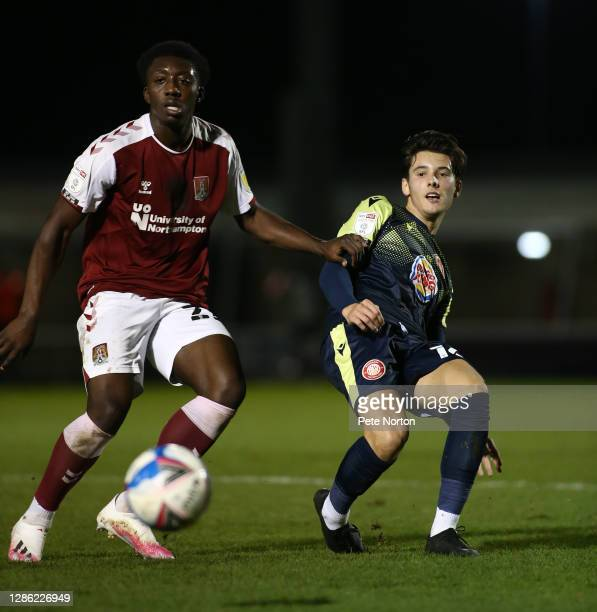 Benny AshleySeal of Northampton Town looks to the ball with Arthur Iontton of Stevenage during the Papa John's Trophy match between Northampton Town...