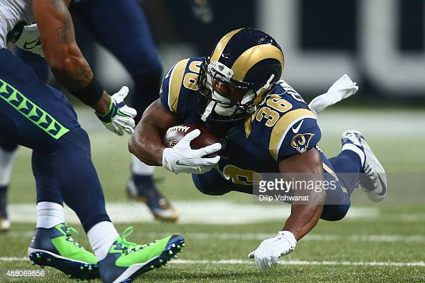 Benny Cunningham of the St Louis Rams rushes against the Seattle Seahawks in the first half at the Edward Jones Dome on September 13 2015 in St Louis...