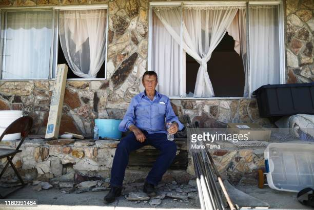 Benny Eldridge sits in front his home which has been deemed uninhabitable due to structural damage from the recent 71 magnitude earthquake on July 8...