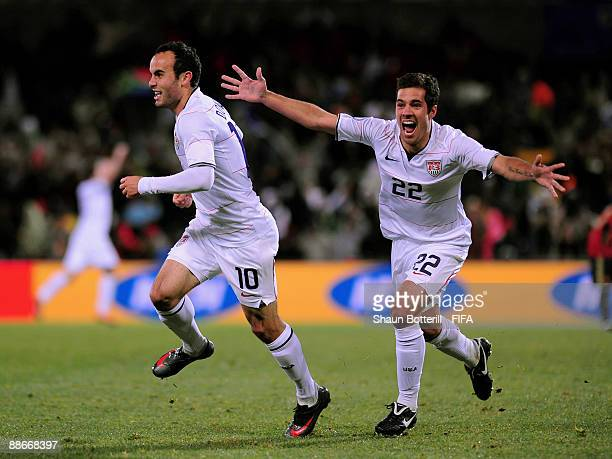 Benny Feilhaber and Landon Donovan of USA celebrate after Clint Dempsey scored the 20 goal during the FIFA Confederations Cup Semi Final between...