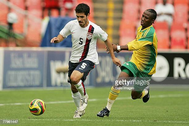 Benny Feilhaber and Teko Modise during the Nelson Mandela Challenge match between South Africa and United States held at Ellis Park Stadium on...