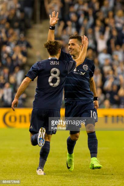 Benny Feilhaber of celebrates with Graham Zusi of Sporting Kansas City after Feilhaber scored a goal outside the penalty box on the San Jose...