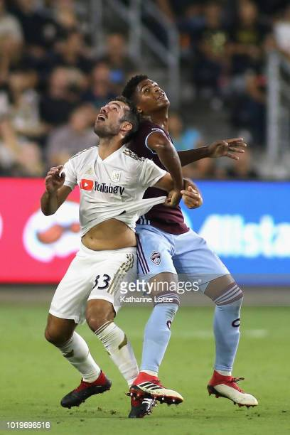 Stefan Aigner of Colorado Rapids and Eduard Atuesta of Los Angeles FC fight for control of the ball at Banc of California Stadium on August 19 2018...