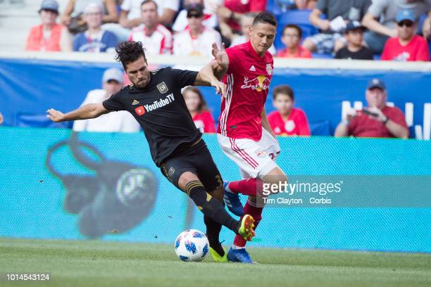 Benny Feilhaber of Los Angeles FC challenged by Sean Davis of New York Red Bulls during the New York Red Bulls Vs Los Angeles FC MLS regular season...