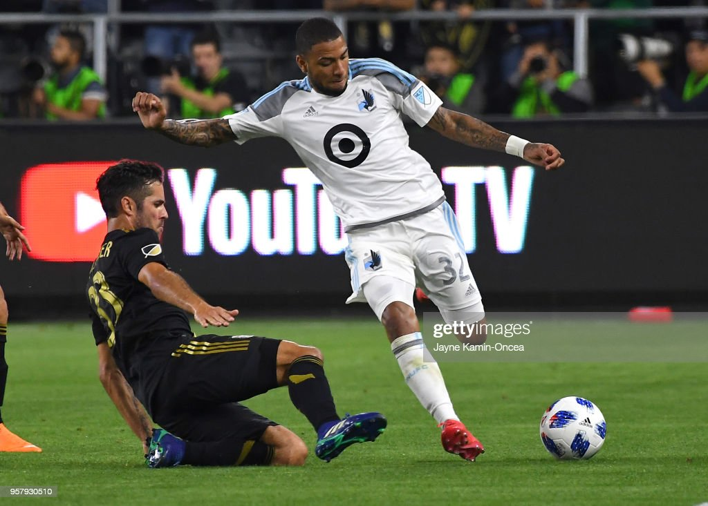 Benny Feilhaber #33 of Los Angeles FC defends a pass by Alexi Gomez #14 of Minnesota United in the game at Banc of California Stadium on May 9, 2018 in Los Angeles, California.