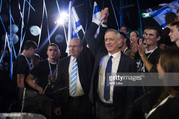 Benny Gantz a former head of the IDF and head of Israel resilience party and former ministery of defence Moshe Ya'alon gesture supportes during a...