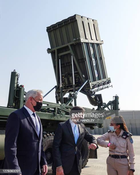 Benny Gantz, Israel's Alternate Prime Minister and Defence Minister, looks on as US Defense Secretary Mark Esper bumps elbows with Israeli Lt. Tovah...