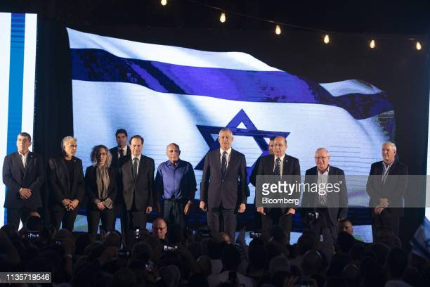 Benny Gantz leader of the Blue and White party center sings during a final campaign rally with top party candidates in Tel Aviv on Sunday April 7...