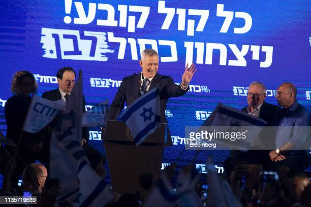 Benny Gantz leader of the Blue and White party waves during a final campaign rally with supporters in Tel Aviv on Sunday April 7 2019 After voting...