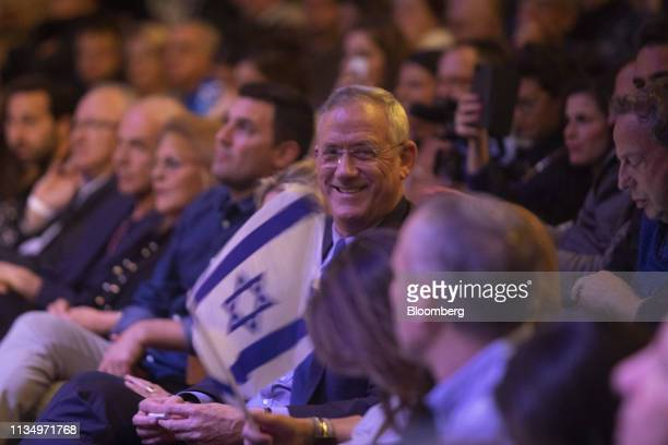 Benny Gantz leader of the Blue White party center sits amongst supporters during a rally at the Cameri theatre in Tel Aviv Israel on Thursday April 4...