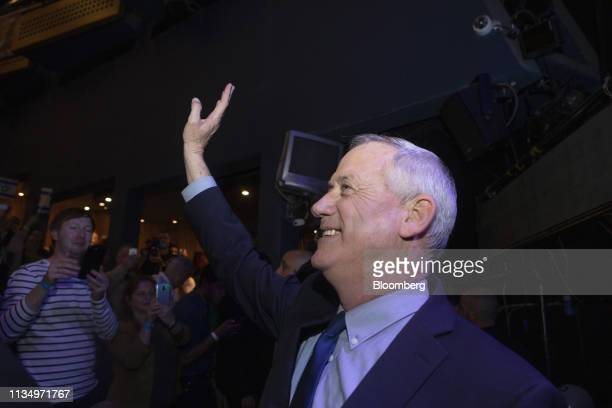 Benny Gantz leader of the Blue White party waves to supporters during a rally at the Cameri theatre in Tel Aviv Israel on Thursday April 4 2019...